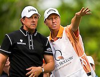 Golfer Phil Mickelson (with his caddie Jim McCay) works the course during the Quail Hollow Championship golf tournament 2009. The event, formerly called the Wachovia Championship, is a top event on the PGA Tour, attracting such popular golf icons as Tiger Woods, Vijay Singh and Bubba Watson. Photo from the second round in the Quail Hollow Championship golf tournament at the Quail Hollow Club in Charlotte, N.C., Friday, May 01, 2009.