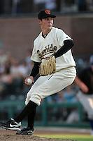 Visalia Rawhide pitcher Trevor Bauer #38 pitches against the Stockton Ports at Recreation Park on July 30, 2011 in Visalia,California. Visalia defeated Stockton 11-2.(Larry Goren/Four Seam Images)