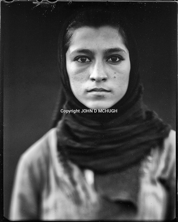 """Madina Saidi, a skateboarder and instructor at the Skateistan NGO, is seen at Bibi Moru in Kabul, 23 August 2012. This portrait was shot on a 5x4 Linhof Technika IV, circa 1959, and a Schneider Kreuznach 270mm lens, circa 1952, with front tilt, and is part of a series entitled """"Putting an Afghan face on the war."""" (John D McHugh)"""