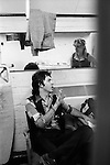 """Paul and Linda McCartney Wings Tour 1975. Paul and Linda in the band rehersal studio dressing room Elstree, London.. The photographs from this set were taken in 1975. I was on tour with them for a children's """"Fact Book"""". This book was called, The Facts about a Pop Group Featuring Wings. Introduced by Paul McCartney, published by G.Whizzard. They had recently recorded albums, Wildlife, Red Rose Speedway, Band on the Run and Venus and Mars. I believe it was the English leg of Wings Over the World tour. But as I recall they were promoting,  Band on the Run and Venus and Mars in particular."""