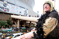 """Jesse Mamury overlooks the wild scene at the start of a parade in Buddy D's honor on January 31, 2010 in New Orleans.<br /> <br /> Thousands of Saints fans wearing dresses paraded from the Louisiana Superdome to the French Quarter to honor a promise made by the late sportscaster and Saints super-fan Buddy Diliberto aka """"Buddy D"""".<br /> <br /> In 1993 Buddy D, who passed away in 2005, remarked on air that if the Saints were to make it to the Super Bowl, he would wear a dress and dance down the streets.  The comment was repeated at various times and never forgotten by his listeners.<br /> <br /> Led by former New Orleans Saints quarterback Bobby Hebert, who has taken Buddy D's place on WWL radio, thousands made good on his promise for him, dancing, drinking, and cavorting their way down the street, alternately yelling out """"Who Dat!"""" and """"Buddy D!"""" in front of an onlooking crowd an estimated 85,000 people strong.<br /> <br /> The hard luck NFL team the New Orleans Saints has reached its first Super Bowl in team history, after 43 years largely filled with losing seasons and futility.  It is difficult to travel anywhere in the area without some reminder of this fact, as the team and city are intertwined perhaps like no other sports franchise in this country."""