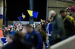 Chester City 1 Altrincham 3, 21/11/2009. Deva Stadium, Football Conference. Home supporters in the West Stand making their way out of the Deva Stadium, Chester, home of Chester City Football Club (in blue), after the club's Blue Square Premier fixture against Cheshire rivals Altrincham, as the visitors celebrate with their flags. The visitors won by three goals to one. Chester were in administration at the start of the season and were penalised 25 points before the season began. Photo by Colin McPherson.