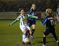 20131213 - VARSENARE , BELGIUM : Zwolle's Jolijn Heuvels (left) pictured during the female soccer match between Club Brugge Vrouwen and PEC Zwolle Ladies , of  matchday 14  in the BENELEAGUE competition. Friday 13th December 2013. PHOTO DAVID CATRY
