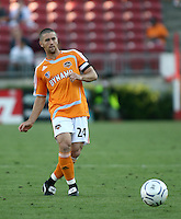 Houston Dynamo defender Wade Barrett (24) passes the ball upfield.   Houston Dynamo beat FC Pachuca 2-0 at Robertson Stadium in Houston, TX on March 15, 2007 in the first of a two game series in the CONCACAF Champions' Cup semi-finals.