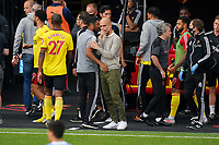 Man City Manager Josep 'PEP' Guardiola  and Watford caretaker manager Hayden Mullins after the Premier League match between Watford and Manchester City at Vicarage Road, Watford, England on 21 July 2020. Football Stadiums around remain empty due to the Covid-19 Pandemic as Government social distancing laws prohibit supporters inside venues resulting in all fixtures being played behind closed doors until further notice.<br /> Photo by Andy Rowland.
