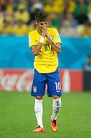 Neymar of Brazil puts his head in his hands