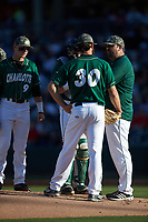Charlotte 49ers pitching coach Brandon Hall (right) has a meeting on the mound with starting pitcher J.D. Prochaska (30) during the game against the North Carolina State Wolfpack at BB&T Ballpark on March 29, 2016 in Charlotte, North Carolina. The Wolfpack defeated the 49ers 7-1.  (Brian Westerholt/Four Seam Images)