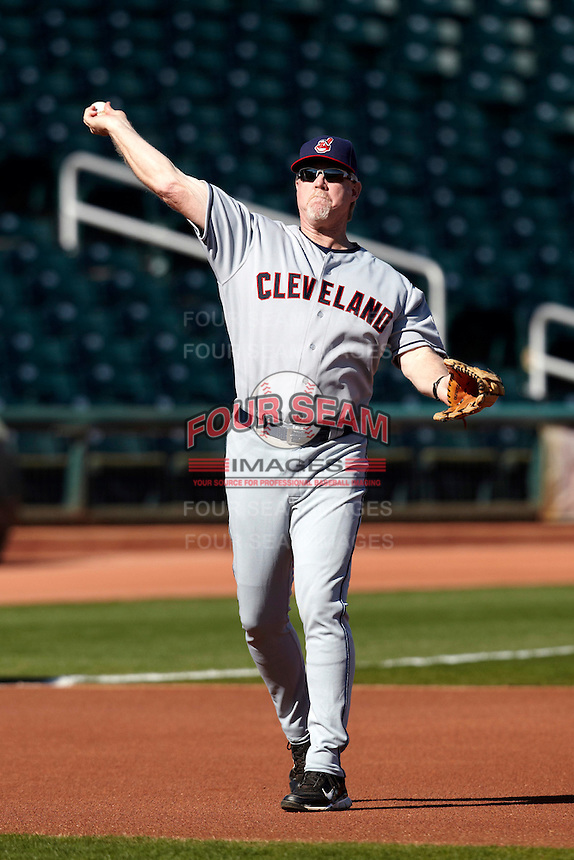 Former major league third baseman Cory Snyder throws to first during a campers vs pros game at the Cleveland Indians Fantasy Camp at Goodyear Stadium on January 19, 2012 in Goodyear, Arizona.  (Mike Janes/Four Seam Images)