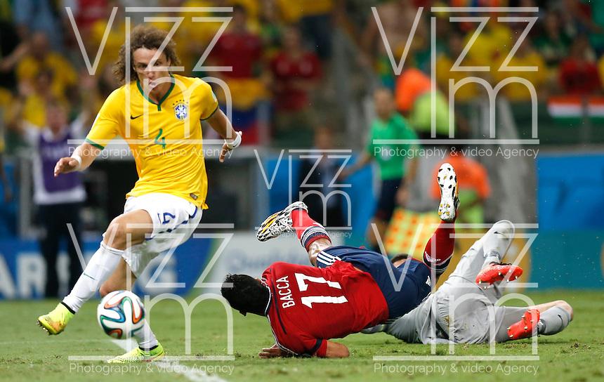 FORTALEZA - BRASIL -04-07-2014. Foto: Roberto Candia /Archivolatino<br /> Carlos Bacca (#10) jugador de Colombia (COL) recibe falta para penal de Julio Cesar (#12) arquero de  Brasil (BRA) mientras David Luiz (#4) coge el balón durante partido de los cuartos de final por la Copa Mundial de la FIFA Brasil 2014 jugado en el estadio Castelao de Fortaleza./ Carlos Bacca (#17) player of Colombia (COL) receives a penalty from Julio Cesar (#12)  Brazil (BRA) while David Luiz (#4) gets the ball during the match of the Quarter Finals for the 2014 FIFA World Cup Brazil played at Castelao stadium in Fortaleza. Photo: Roberto Candia /Archivolatino<br /> VizzorImage PROVIDES THE ACCESS TO THIS PHOTOGRAPH ONLY AS A PRESS AND EDITORIAL SERVICE IN COLOMBIA AND NOT IS THE OWNER OF COPYRIGHT; ANOTHER USE IS REPONSABILITY OF THE END USER. NO SALES, NO MERCHANDASING. ALL COPYRIGHT IS ARCHIVOLATINO