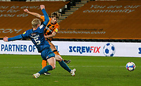 Hull City's Martin Samuelsen shoots at goal under pressure from Grimsby Town's Ludvig Ohman<br /> <br /> Photographer Alex Dodd/CameraSport<br /> <br /> EFL Papa John's Trophy - Northern Section - Group H - Hull City v Grimsby Town - Tuesday 17th November 2020 - KCOM Stadium - Kingston upon Hull<br />  <br /> World Copyright © 2020 CameraSport. All rights reserved. 43 Linden Ave. Countesthorpe. Leicester. England. LE8 5PG - Tel: +44 (0) 116 277 4147 - admin@camerasport.com - www.camerasport.com