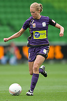 MELBOURNE, AUSTRALIA - DECEMBER 18: Alexandra NILSSON of the Glory runs with the ball during the round 7 W-League match between the Melbourne Victory and the Perth Glory at AAMI Park on December 18, 2010 in Melbourne, Australia. (Photo Sydney Low / asteriskimages.com)