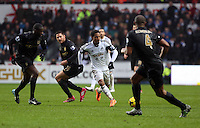 Wednesday, 01 January 2014<br /> Pictured: Jonathan de Guzman of Swansea (3rd L) passing the ball.<br /> Re: Barclay's Premier League, Swansea City FC v Manchester City at the Liberty Stadium, south Wales.