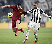 Calcio, Serie A: Juventus - AS Roma, Torino, Allianz Stadium, 23 dicembre, 2017. <br /> Roma's Konstantinos Manolas (l) in action with Juventus' Gonzalo Higuain (r) during the Italian Serie A football match between Juventus and Roma at Torino's Allianz stadium, December 23, 2017.<br /> UPDATE IMAGES PRESS/Isabella Bonotto