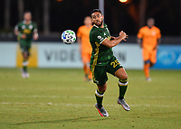 LAKE BUENA VISTA, FL - JULY 18: Bill Tuiloma #25 of the Portland Timbers runs onto a pass during a game between Houston Dynamo and Portland Timbers at ESPN Wide World of Sports on July 18, 2020 in Lake Buena Vista, Florida.