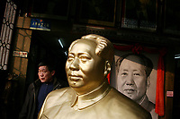 CHINA. Hubei Province. Wuhan. A man walks past a statue of the former Chinese leader Mao Zedong in the gardens of The Yellow Crane Tower which looks over the Yangtze and the city of Wuhan.  2008