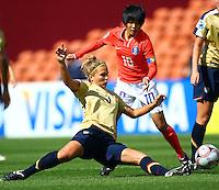 Amber Brooks (USA) slides in to defend the ball..FIFA U17 Women's World Cup, USA v Korea Republic, Waikato Stadium, Hamilton, New Zealand, Sunday 9 November 2008. Photo: Renee McKay/PHOTOSPORT