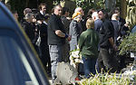 The funeral of the late music manager and punk pioneer Malcolm McLaren in London this afternoon. Eddie Tenpole Tudor, Adam Ant and Vivienne Westwood..