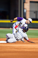 Matty Johnson (2) of the Salem Red Sox is tagged out by Joey DeMichele (18) of the Winston-Salem Dash as he tries to steal second base at BB&T Ballpark on April 20, 2014 in Winston-Salem, North Carolina.  The Dash defeated the Red Sox 10-8.  (Brian Westerholt/Four Seam Images)