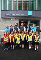 Manager Aled Jones (TOP 4th from LEFT) with area manager Chris Ellis (5th from LEFT) with colleagues and pupils, members of the Urdd from Ysgol Bryn Y Mor School.