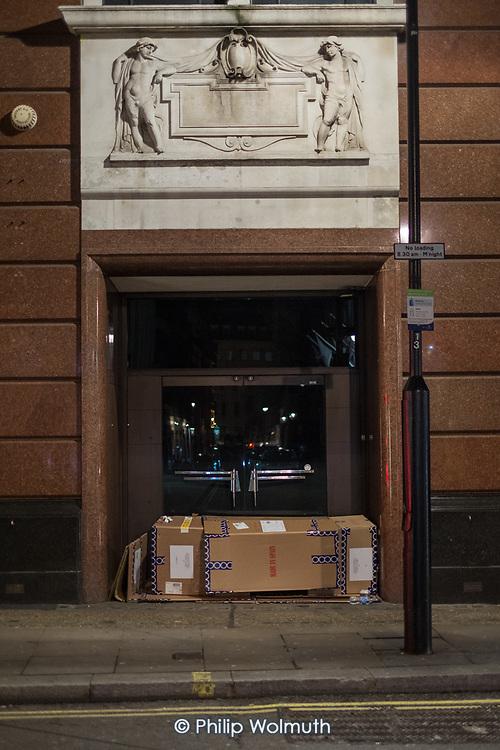 Rough sleeper in the doorway of Massimo Dutti clothing store, Beak Street, Soho, London.