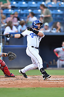 Asheville Tourists Cesar Salazar (11) swings at a pitch during a game against the Greenville Drive on July 14, 2021 at McCormick Field in Asheville, NC. (Tony Farlow/Four Seam Images)