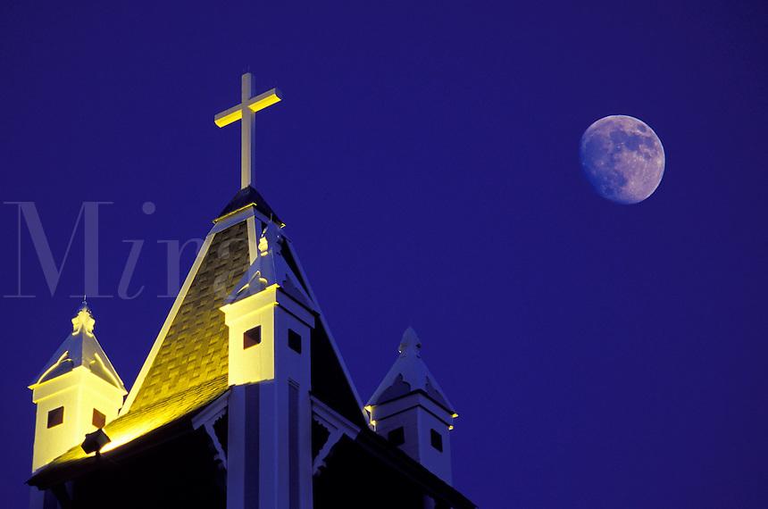 Church steeple at night with full moon, Coupeville, Washington.