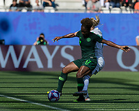 GRENOBLE, FRANCE - JUNE 22: Francisca Ordega #17 of the Nigerian National Team attempts to control the ball as Verena Schweers #17 of the German National Team pressures during a game between Nigeria and Germany at Stade des Alpes on June 22, 2019 in Grenoble, France.