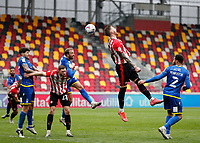 20th March 2021; Brentford Community Stadium, London, England; English Football League Championship Football, Brentford FC versus Nottingham Forest; Pontus Jansson of Brentford heads the ball from a Brentford cross