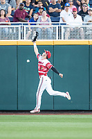 Louisville Cardinals outfielder Drew Campbell (1) attempts to make a catch during Game 10 of the NCAA College World Series against the Mississippi State Bulldogs on June 20, 2019 at TD Ameritrade Park in Omaha, Nebraska. Louisville defeated Mississippi State 4-3. (Andrew Woolley/Four Seam Images)