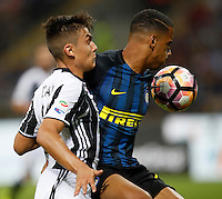 Calcio, Serie A: Inter vs Juventus. Milano, stadio San Siro, 18 settembre 2016.<br /> Juventus' Paulo Dybala, left, and Inter's Senna Milangue fight for the ball during the Italian Serie A football match between FC Inter and Juventus at Milan's San Siro stadium, 18 September 2016.<br /> UPDATE IMAGES PRESS/Isabella Bonotto