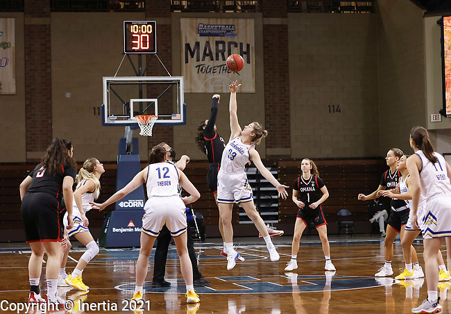 SIOUX FALLS, SD - MARCH 6: Paiton Burckhard #33 of the South Dakota State Jackrabbits jumps the opening tip against Josie Filer #25 of the Omaha Mavericks during the Summit League Basketball Tournament at the Sanford Pentagon in Sioux Falls, SD. (Photo by Richard Carlson/Inertia)