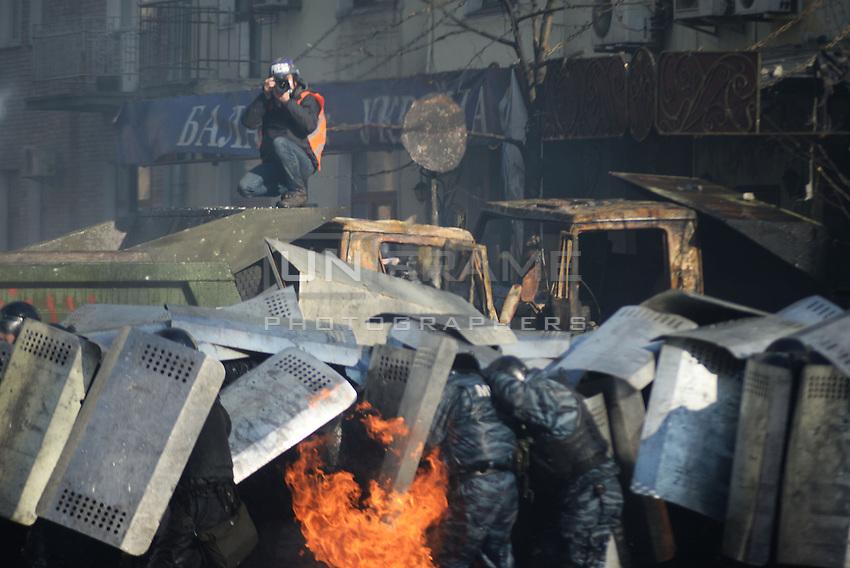 A police line under the attack of molotov cocktails. Kiev, Ukraine