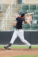 Nolan Early (9) of the Kannapolis Intimidators follows through on his swing against the Asheville Tourists at CMC-NorthEast Stadium on July 13, 2014 in Kannapolis, North Carolina.  The Tourists defeated the Intimidators 8-2.  (Brian Westerholt/Four Seam Images)