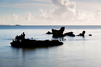 The wreck of the ship 'Van Camp' lies off of the coast of the island of Fongafale in the Funafuti atoll. The ship ran aground during a typhoon in the 1970's. The last remnants of the ship's shell are slowly disappearing to the ocean. Tuvalu is made up of a collection of small islands and coral atolls, totalling only 27 square kilometres, scattered over 500,000 square kilometres of ocean. The highest point throughout the country is only 5 metres above sea level, resulting in special vulnerability to sea level rise. Funafuti, Tuvalu. March, 2019.