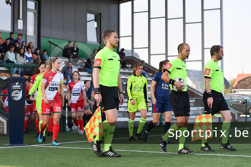 referee Christophe Windels with assistant referees Toon Bonduel and Jiri Bergs pictured entering the pitch with the players during a female soccer game between SV Zulte - Waregem and Oud Heverlee Leuven on the sixth matchday of the 2021 - 2022 season of Belgian Scooore Womens Super League , saturday 9 of October 2021  in Zulte , Belgium . PHOTO SPORTPIX | DIRK VUYLSTEKE