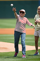 Harriette Thompson, who at the age of 92 recently became the oldest woman to complete a marathon, throws out a ceremonial first pitch prior to the International League game between the Norfolk Tides and the Charlotte Knights at BB&T BallPark on June 7, 2015 in Charlotte, North Carolina.  The Tides defeated the Knights 4-1.  (Brian Westerholt/Four Seam Images)