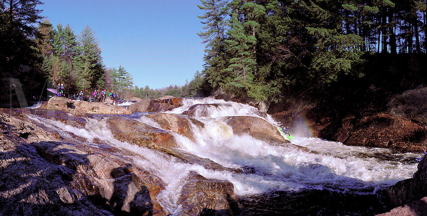 Kayakers running Crystal Falls on the Moose River. Lyons Falls New York United States Adirondacks.