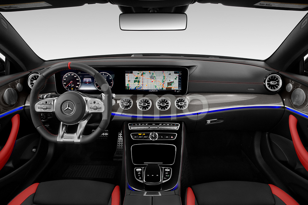 Stock photo of straight dashboard view of 2019 Mercedes Benz E-Class AMG-E53 2 Door Coupe Dashboard