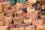 Purses sit in a market stall, Ubud, Indonesia.