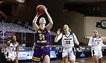 SIOUX FALLS, SD - MARCH 7: Evan Zars #54 of the Western Illinois Leathernecks gets past Paige Bradford #23 of the UMKC Kangaroos during the Summit League Basketball Tournament at the Sanford Pentagon in Sioux Falls, SD. (Photo by Richard Carlson/Inertia)