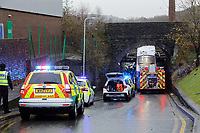 Police and fire service personnel at the scene of an accident involving a double decker bus that crashed under a railway bridge in the Hafod area of Swansea, Wales, UK. Thursday 12 December 2019