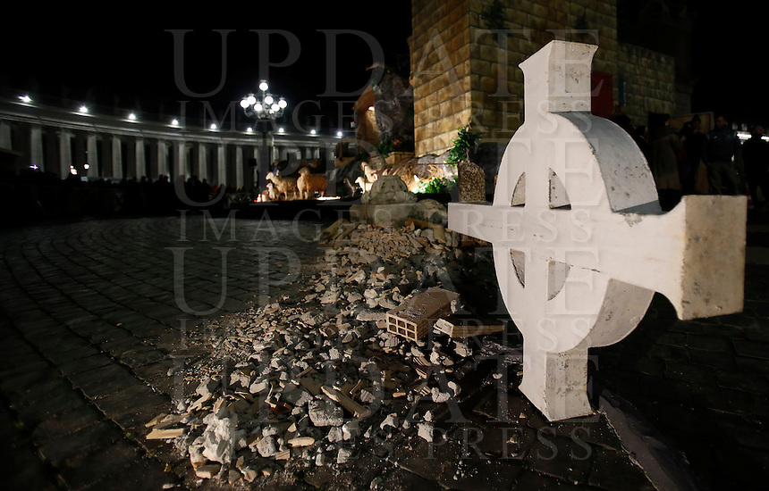 The cross and few debris of the Saint Benedict Basilica of Norcia, one of the towns hit by the recent earthquake in Central Italy, pictured in Saint Peter square at the Vatican, on December 9, 2016. <br /> UPDATE IMAGES PRESS/Isabella Bonotto<br /> <br /> STRICTLY ONLY FOR EDITORIAL USE