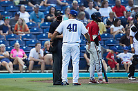 Kannapolis Cannon Ballers manager Guillermo Quiroz (40) discusses a call with home plate umpire Macon Hammond during the game against the Carolina Mudcats at Atrium Health Ballpark on June 9, 2021 in Kannapolis, North Carolina. (Brian Westerholt/Four Seam Images)