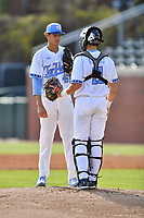 North Carolina Tar Heels starting pitcher Austin Bergner (45) and catcher Cody Roberts (11) during a game against the Pittsburgh Panthers at Boshamer Stadium on March 17, 2018 in Chapel Hill, North Carolina. The Tar Heels defeated the Panthers 4-0. (Tony Farlow/Four Seam Images)