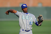 Right fielder Elier Hernandez (12) of the Lexington Legends warms up before a game against the Greenville Drive on Tuesday, April 14, 2015, at Fluor Field at the West End in Greenville, South Carolina. Lexington won, 5-3. (Tom Priddy/Four Seam Images)
