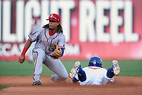 Syracuse Chiefs shortstop Emmanuel Burriss (3) waits for a throw as Jon Berti (8) slides into second base during a game against the Buffalo Bisons on July 3, 2017 at Coca-Cola Field in Buffalo, New York.  Buffalo defeated Syracuse 6-2.  (Mike Janes/Four Seam Images)