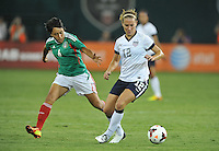 Lauren Holiday (12) of the USWNT goes against Liliana Mercado (6) of Mexico.  The USWNT defeated Mexico 7-0 during an international friendly, at RFK Stadium, Tuesday September 3 , 2013.