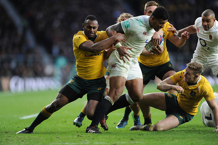 Nathan Hughes of England is tackled by Tevita Kuridrani of Australia during the Old Mutual Wealth Series match between England and Australia at Twickenham Stadium on Saturday 3rd December 2016 (Photo by Rob Munro)