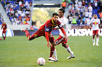 Paulo Araujo Jr. (23) of Real Salt Lake fights through a tackle by Roy Miller (7) of the New York Red Bulls. The New York Red Bulls and Real Salt Lake played to a 0-0 tie during a Major League Soccer (MLS) match at Red Bull Arena in Harrison, NJ, on October 09, 2010.