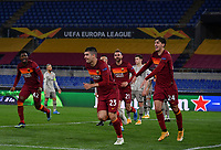 Football Soccer: Europa League -Round of 16 1nd leg AS Roma vs FC Shakhtar Donetsk, Olympic Stadium. Rome, Italy, March 11, 2021.<br /> Roma's Gianluca Mancini (C) celebrates after scoring with is teammates during the Europa League football soccer match between Roma and  Shakhtar Donetsk at Olympic Stadium in Rome, on March 11, 2021.<br /> UPDATE IMAGES PRESS/Isabella Bonotto